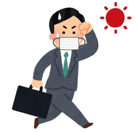 炎天下にマスクをして走っているサラリーマンが汗をかいている